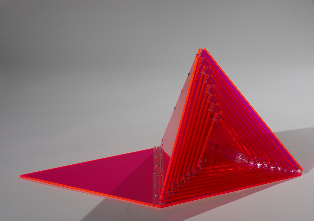 "Marta Chilindrón, ""Orange Pyramid"", 2010, Fluorescent orange plexi, plastic hinges and screws, 18 x 18 x 18 in. when closed. Photo credit: Arturo Sanchez."