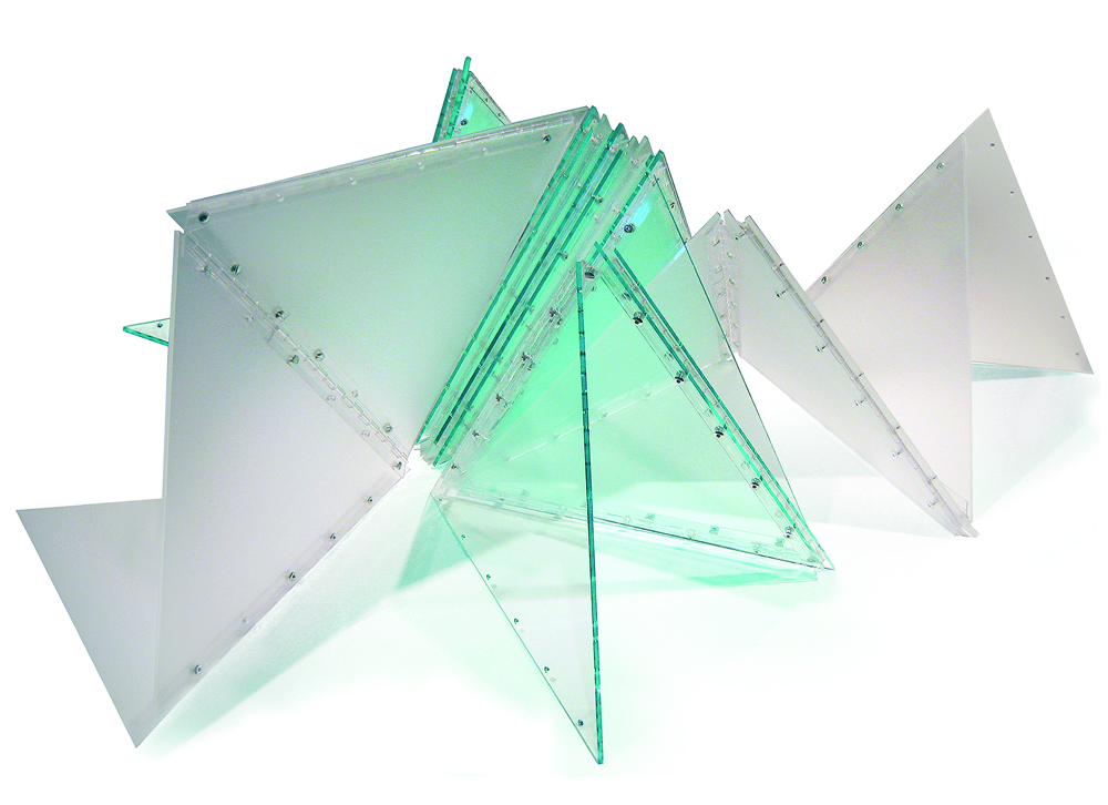 "Marta Chilindrón, ""Twenty-Seven Triangles"", 2010, Clear 3030 and DP9 frosted plexi, plastic hinges and screws, 16 x 18 x 12 in. when completely closed. Photo credit: Alejandra von Hartz Gallery."