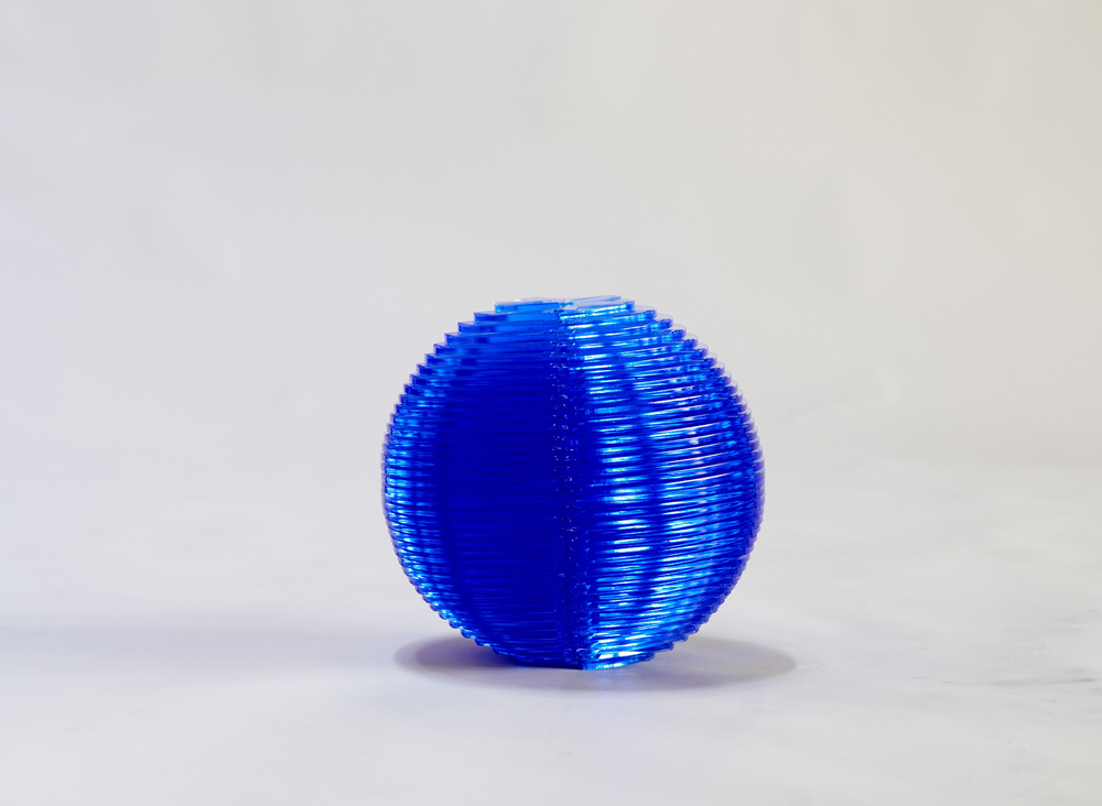 "Marta Chilindrón, ""Sphere 12"", 2009, Fluorescent blue plexi, plastic hinges, 12 x 12 x 12 in. when closed. Photo credit: Arturo Sanchez."